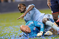 CJ Sapong, (17) Sporting KC collides with New England goalkeeper Matt Reis... Sporting Kansas City defeated New England Revolution 3-0 at LIVESTRONG Sporting Park, Kansas City, Kansas.