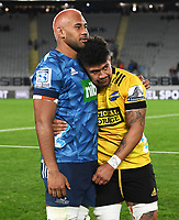 14th June 2020, Aukland, New Zealand;  Blues captain Patrick Tuipulotu and Ardie Savea embrace after the game at the Investec Super Rugby Aotearoa match, between the Blues and Hurricanes held at Eden Park, Auckland, New Zealand.