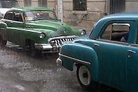 oldtimer driving in hard  rain, Havana Cantro