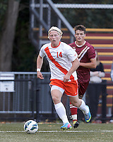 Syracuse University forward Emil Ekblom (14) looks to pass.Boston College (maroon) defeated Syracuse University (white/orange), 3-2, at Newton Campus Field, on October 8, 2013.