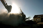 A house is being demolished by a bulldozer, at the settlement of Pe'at Sadeh, in the Israeli settlement bloc of Gush Katif, Gaza Strip, after it was evacuated during the Disengagement.