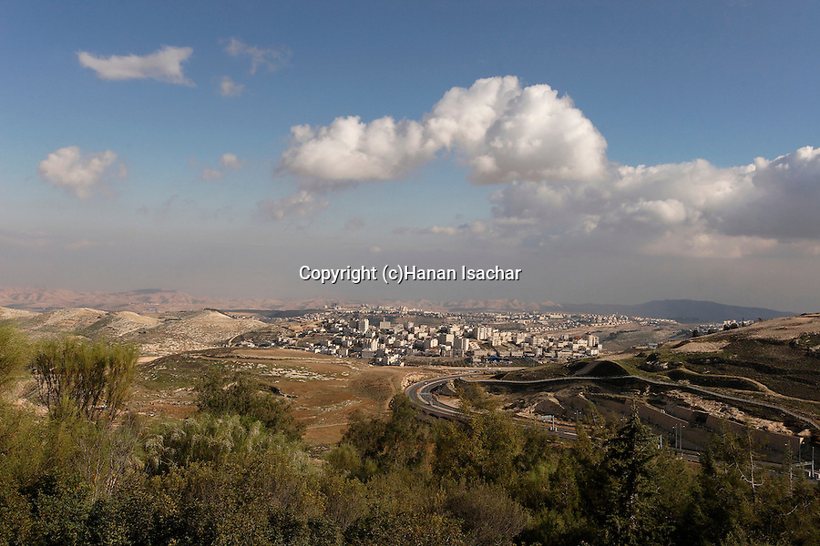 Israel, Jerusalem, A view of the Judean desert from the eastern side of Mount Scopus. Ma'ale Adumim is seen behind the Palestinian neighborhood El Azzariya