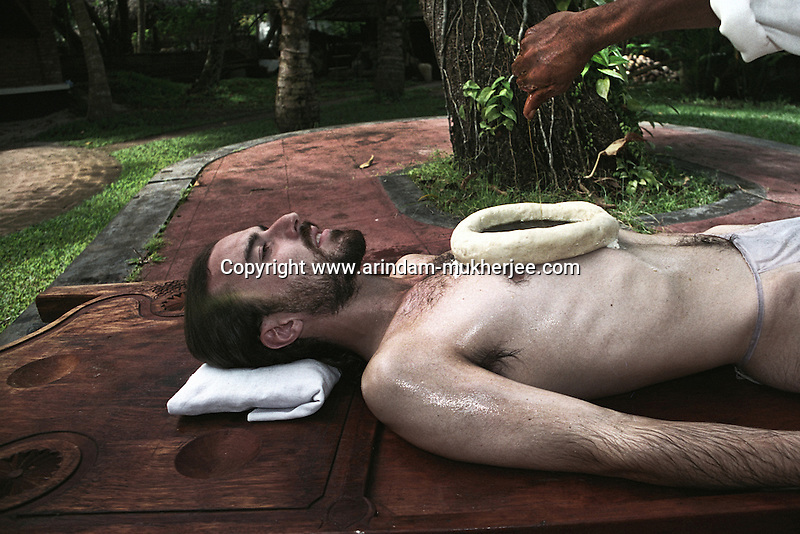 Ayurvedic treatment at an Ayurvedic resort at Alleppey, Kerala, India.