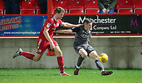Lincoln City's Adam Crookes crosses the ball despite the attentions of Accrington Stanley's Matthew Platt<br /> <br /> Photographer Andrew Vaughan/CameraSport<br /> <br /> The EFL Checkatrade Trophy Second Round - Accrington Stanley v Lincoln City - Crown Ground - Accrington<br />  <br /> World Copyright &copy; 2018 CameraSport. All rights reserved. 43 Linden Ave. Countesthorpe. Leicester. England. LE8 5PG - Tel: +44 (0) 116 277 4147 - admin@camerasport.com - www.camerasport.com