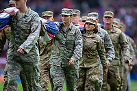 3rd November 2019; Wembley Stadium, London, England; National Football League, Houston Texans versus Jacksonville Jaguars; The US Air Force carry the flags from the pitch - Editorial Use