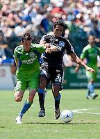 Andre Luiz (28) battles against Sebastien Le Toux (9). The San Jose Earthquakes defeated Seattle Sounders FC 4-0 at Buck Shaw Stadium in Santa Clara, California on August 2, 2009.