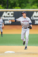 Virginia Cavaliers shortstop Daniel Pinero (22) makes a throw to first base against the Wake Forest Demon Deacons at Wake Forest Baseball Park on May 17, 2014 in Winston-Salem, North Carolina.  The Demon Deacons defeated the Cavaliers 4-3.  (Brian Westerholt/Four Seam Images)