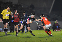 Sale Sharks Cameron Neild hand off's Saracens No 9 Richard Wigglesworth during the European Rugby Champions Cup match between Sale Sharks and Saracens at AJ Bell Stadium, Salford, England on 18 December 2016. Photo by Paul Bell.