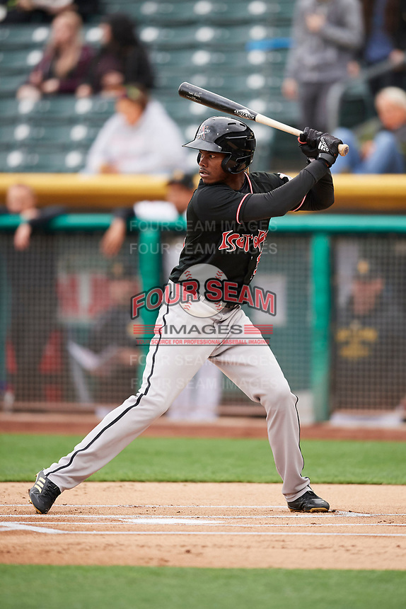 Raimel Tapia (15) of the Albuquerque Isotopes bats against the Salt Lake Bees at Smith's Ballpark on April 5, 2018 in Salt Lake City, Utah. Salt Lake defeated Albuquerque 9-3. (Stephen Smith/Four Seam Images)