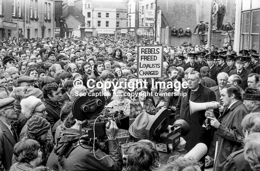 Loyalist politicians Rev Ian Paisley and Ernest Baird (with the microphone) lead a UUAC strike protest in Portadown, N Ireland, May, 1977. 19770506341<br /> Copyright Image from Victor Patterson, 54 Dorchester Park, <br /> Belfast, UK, BT9 6RJ<br /> <br /> t1: +44 28 9066 1296 (from Rep of Ireland 048 9066 1296)<br /> t2: +44 28 9002 2446 (from Rep of Ireland 048 9002 2446)<br /> m: +44 7802 353836<br /> <br /> e1: victorpatterson@me.com<br /> e2: victorpatterson@gmail.com<br /> <br /> www.victorpatterson.com<br /> <br /> Please see my Terms and Conditions of Use at VICTORPATTERSON.COM. It is IMPORTANT that you familiarise yourself with them.<br /> <br /> Images used on the Internet must be visibly watermarked i.e. &copy;VICTORPATTERSON.COM within the body of the image and copyright metadata must not be deleted. Images used on the Internet have a size restriction of 4kbs and are chargeable at the then current NUJ rates.<br /> <br /> This image is only available for the use of the download recipient i.e. television station, newspaper, magazine, book publisher, etc, and must not be passed on to any third party. It is also downloaded on condition that each and every usage is notified within 7 days to victorpatterson@me.com<br /> <br /> The right of Victor Patterson to be identified as the author is asserted in accordance with The Copyright Designs And Patents Act (1988).