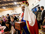 WATERBURY, CT - 06 JANUARY 2010 -010610JT11--<br /> Anibal Santiago, dressed as one of the Three Kings, enters the auditorium  at the River Baldwin Recreation Center during Wednesday's Three Kings Day celebration in Waterbury, hosted by the Hispanic Coalition. The event, which was dedicated to Marine Cpl. Xhacob LaTorre, who died in December from combat wounds suffered in Afghanistan, featured dancers, food, and gifts for children.<br /> Josalee Thrift Republican-American