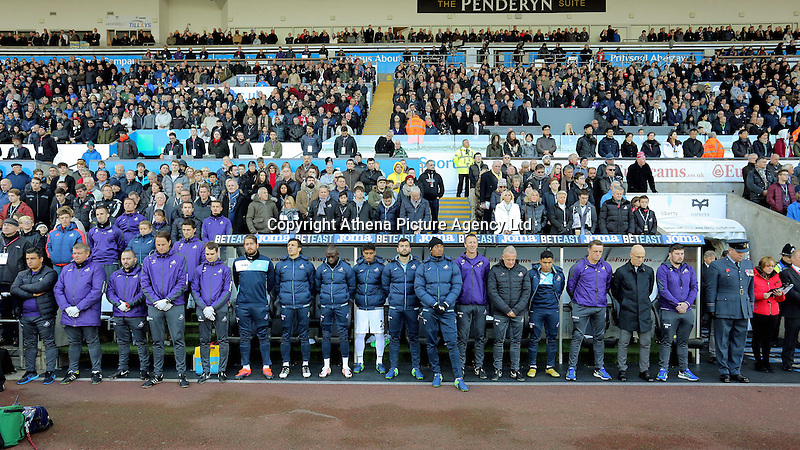 Swansea City staff observe a minute's silence prior to the Premier League match between Swansea City and Manchester United at The Liberty Stadium, Swansea, Wales, UK. Sunday 06 November 2016