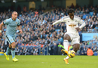 Picture by Howard Roe/AHPIX.com. Football, Barclays Premier League; <br /> Manchester City v Swansea City ;22/11/2014 KO 3.00 pm <br /> Etihad Stadium;<br /> copyright picture;Howard Roe;07973 739229<br /> Swansea's Wilfred Bony slots home the opener against  Manchester