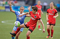 Portland, Oregon - Wednesday June 22, 2016: Portland Thorns FC defender Meghan Klingenberg (25) receives a pass in front of Chicago Red Stars midfielder Amanda Da Costa (13) during a regular season National Women's Soccer League (NWSL) match at Providence Park.