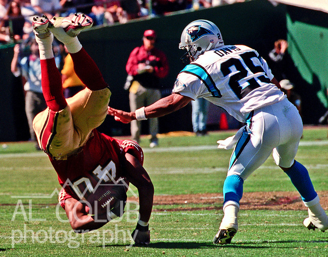 San Francisco 49ers vs. Carolina Panthers at Candlestick Park Sunday, September 10, 2000. Panthers beat 49ers 38-22.  Carolina Panthers defensive back Eric Davis (25) and San Francisco 49ers full back Fred Beasley (40).