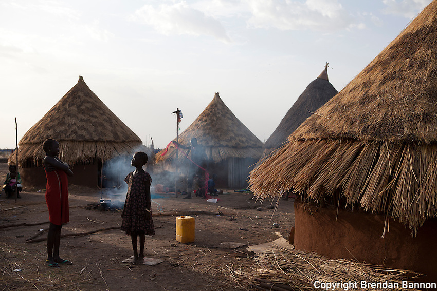 Children play and prepare a fire to cook dinner in the TB village at MSF's hospital in Nasir, South Sudan.