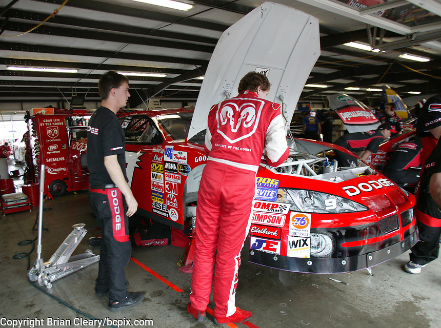 Bill Elliott looks under the hood of his car as his crew prepares in for the Pop Secret 400 NASCAR Winston Cup race at Rockingham, NC on Sunday, November 9, 2003. (Photo by Brian Cleary)