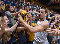 California's Justin Cobbs celebrates with the fans after beating Colorado in overtime at Haas Pavilion in Berkeley, California on March 8th, 2014. California defeated Colorado 66 - 65