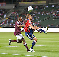 Chivas USA defender Jimmy Conrad (12) passes the ball back over his head and Colorado Rapids defender Marvell Wynne (22) during the first half of the game between Chivas USA and Colorado Rapids at the Home Depot Center in Carson, CA, on March 26, 2011. Final score Chivas USA 0, Colorado Rapids 1.