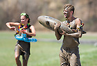 Apr 27, 2014;  Students participate in Muddy Sunday, a volleyball tournament played in the mud at White Fields in support of Habitat for Humanity. Photo by Barbara Johnston/University of Notre Dame