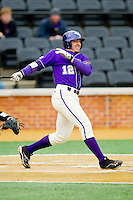 Cody Jones (12) of the Western Carolina Catamounts follows through on his swing against the Wake Forest Demon Deacons at Wake Forest Baseball Park on March 26, 2013 in Winston-Salem, North Carolina.  The Demon Deacons defeated the Catamounts 3-1.  (Brian Westerholt/Four Seam Images)