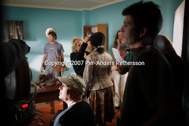 GABORONE, BOTSWANA - AUGUST 14: Anthony Minghella (c), the Oscar-winning director, instructs the actors on the set of The No 1 Ladies Detective Agency on August 14, 2007 in Gaborone, Botswana. The film is based on Alexander McCall Smith?s best-selling series. Mr. Minghella and his crew filmed for months around Botswana and the Government of Botswana has invested $US5 Million in the project. (Photo by Per-Anders Pettersson/Getty Images)....