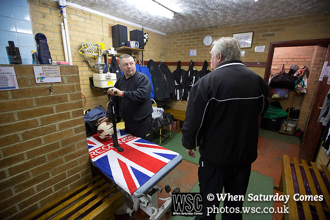 Tow Law Town 2 Heaton Stannington 2, 25.02.2014. Ironworks Road, Tow Law. Background staff preparing the kit in the dressing room at the home of Tow Law Town, the Ironworks Road ground, before the club hosted Heaton Stannington in a Northern League division two fixture. It was the visitors first visit to Tow Law, having been promoted from the Northern Alliance last season. The match ended in a 2-2 draw, with the home team equalising in the last minute after having their goalkeeper sent off. Photo by Colin McPherson.