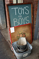 Toys for boys sign outsude an antique store on Main Street, Vancouver, BC, Canada