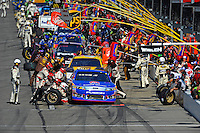 Greg Biffle (#16) makes a pit stop at the head of the field.