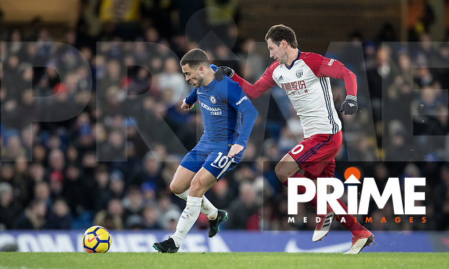 Eden Hazard of Chelsea & Grzegorz Krychowiak of WBA during the Premier League match between Chelsea and West Bromwich Albion at Stamford Bridge, London, England on 12 February 2018. Photo by Andy Rowland.