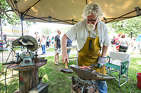 NWA Democrat-Gazette/BEN GOFF @NWABENGOFF<br /> Steve Low of Slow Fire Forge in Gentry hammers a decorative piece Thursday, July 4, 2019, during the 125th annual Gentry Freedom Fest at Gentry City Park.