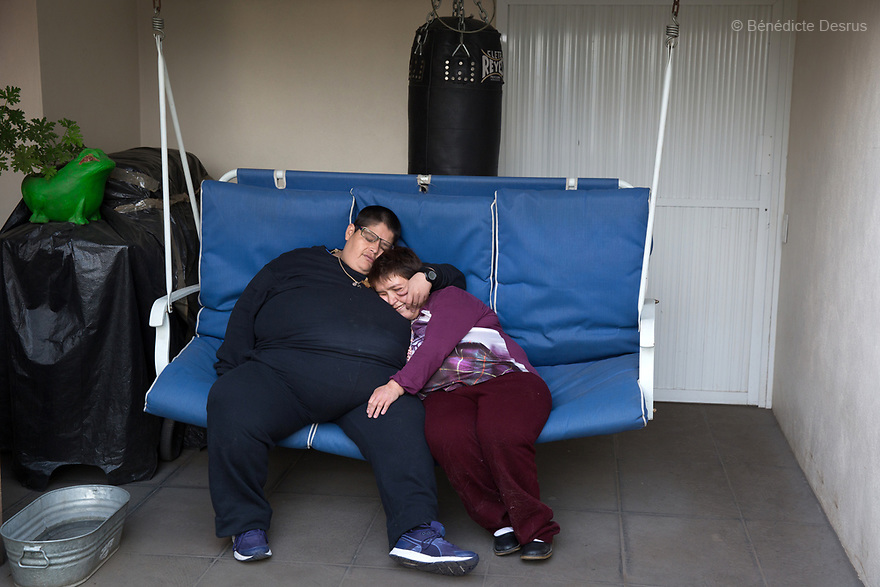 Lupita and her boyfriend Jorge rest on the rooftop terrace of her home in Mexico City, Mexico on March 31, 2017. Maria Guadalupe Pilar Saucedo Granda, 43, and Jorge Antonio Moreno Gaytán, 34, both diagnosed with Prader-Willi syndrome, have been in a relationship for 11 years. They met at an annual meeting organized by the Mexican Prader-Willi Association Fundación María José in Pachuca, Mexico. They call each other daily but only see each other three to four times a year. They dream about getting married one day. Prader-Willi Syndrome (PWS) is a rare genetic disorder caused by an abnormality in chromosome 15. In newborns symptoms include weak muscle tone (hypotonia), poor appetite and slow development. In childhood the person experiences a sensation of constant hunger no matter how much he/she eats which often leads to obesity and Type 2 diabetes. There may also be mild to moderate intellectual impairment and behavioral problems. Physical characteristics include a narrow forehead, small hands and feet, short in stature, and light skin color. Prader-Willi syndrome has no known cure. However, with early diagnosis and treatment such as growth hormone therapy, the condition may improve. Strict food supervision is typically required. PWS affects an estimated 1 in 10,000 to 30,000 people worldwide. (Photo by Bénédicte Desrus)