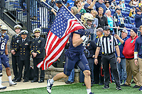 Annapolis, MD - October 26, 2019: Navy Midshipmen linebacker Tyler Pistorio (41) carries the flag before the game between Tulane and Navy at  Navy-Marine Corps Memorial Stadium in Annapolis, MD.   (Photo by Elliott Brown/Media Images International)