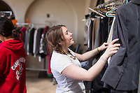 Occidental College students look through clothes donated by alumni at the Dress For Success event, March 27, 2014 in the Samuelson Alumni Center, hosted by the Career Development Center.<br /> (Photo by Aseem Mangaokar '15, photography assistant)
