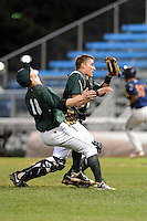 Jamestown Jammers third baseman Adam Landecker (18) and catcher Reese McGuire (7) avoid a collision while attempting to catch a pop up during a game against the State College Spikes on September 3, 2013 at Russell Diethrick Park in Jamestown, New York.  State College defeated Jamestown 3-1.  (Mike Janes/Four Seam Images)