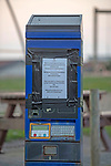 Swansea, UK, 24th April 2020.<br />Council notices on the pay station about the blocked off car park at Bracelet Bay in Limeslade near Swansea today due to the Coronavirus.