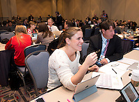 Assistant coach / player Cat Whitehill talks with other staff members during the NWSL draft at the Pennsylvania Convention Center in Philadelphia, PA, on January 17, 2014.