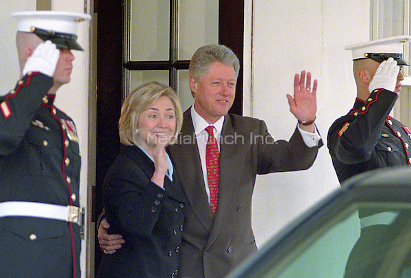United States President Bill Clinton and first lady Hillary Rodham Clinton wave farewell to King Hussein of Jordan following a meeting at the White House in Washington, D.C on March 19, 1998.<br /> Credit: Ron Sachs / CNP/MediaPunch