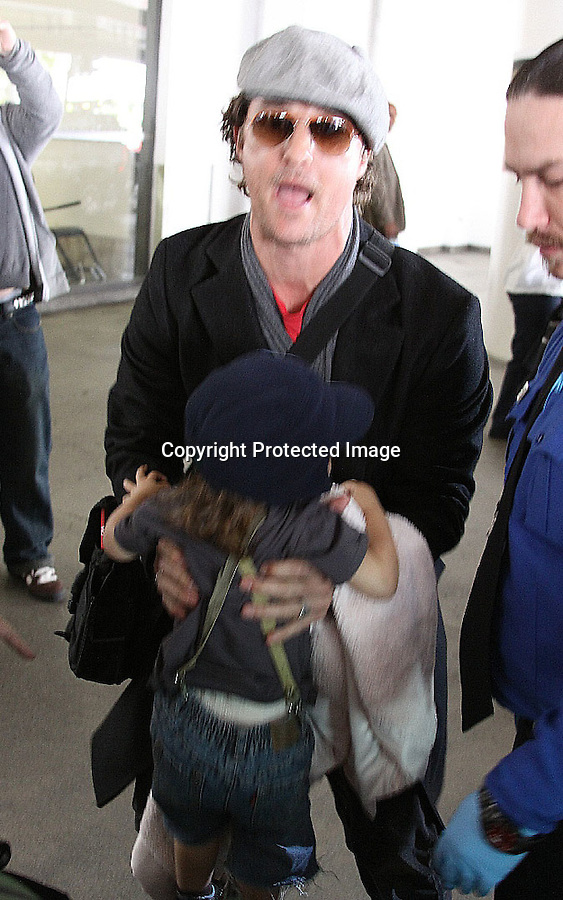 ..3-14-2010.Sunday ....  Matthew McConaughey arriving at the L.A.X airport coming from New York with his son Levi & baby Vida & Camila Alves. Matthew looked a little tired & sweaty from the flight wearing a beret hat. ...AbilityFilms@yahoo.com.805-427-3519.www.AbilityFilms.com