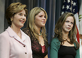 First lady Laura Bush (left) and her daughters Jenna, (center) and Barbara (right) listen to United States President George W. Bush deliver his victory speech during an event at the Ronald Reagan Building, November 3, 2004 in Washington DC. After deciding not to contest the votes in the battleground state of Ohio, Democratic presidential candidate Senator John Kerry (Democrat of Massachusetts) called President Bush to concede and congratulated him.     <br /> Credit: Mark Wilson / Pool via CNP