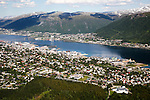 Aerial view of Tromso city showing harbour and suburban housing, Norway