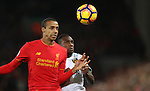 Joel Matip of Liverpool and Michail Antonio of West Ham United challenge for the ball during the Premier League match at Anfield Stadium, Liverpool. Picture date: December 11th, 2016.Photo credit should read: Lynne Cameron/Sportimage