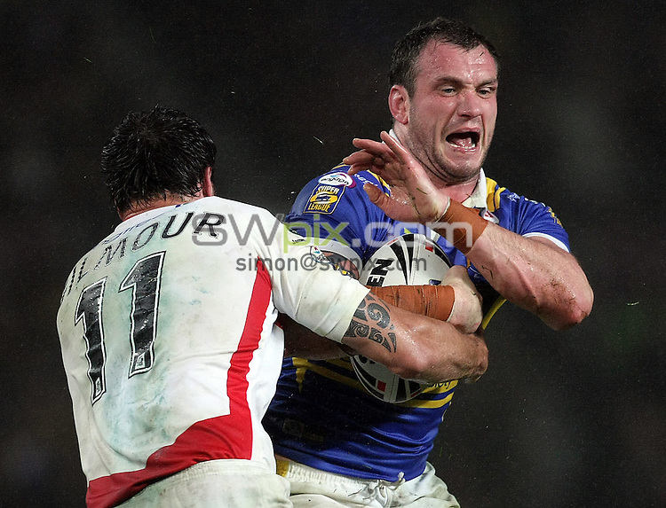 PICTURE BY VAUGHN RIDLEY/SWPIX.COM - Rugby League - Super League Grand Final - St. Helens Saints v Leeds Rhinos - Old Trafford, Manchester, England - 04/10/08...Copyright - Simon Wilkinson - 07811267706...St Helens Lee Gilmour and Leeds Jamie Peacock.