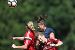 CARY, NC - JUNE 10: NC Courage trialist Maria Lubrano (right) heads the ball over two CASL players. The North Carolina Courage held a scrimmage against the CASL Red South U16 Boys team on June 10, 2017, at WakeMed Soccer Park Field 7 in Cary, NC.