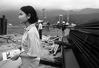 Volunteers from an NGO distrubute condoms and information material about HIV/AIDS to workers at a construction site in Loc Hai, Vietnam on October 28, 2000.  Worldwide, more than 20 million people have died since the first cases of AIDS were identified in 1981.