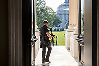 A Capitol Hill Police officer stands his post at the entrance to the House of Representatives on Capitol Hill in Washington, Wednesday, June 14, 2017, after House Majority Whip Steve Scalise of La. was shot at a congressional baseball practice in Alexandria, Va.  (AP Photo/J. Scott Applewhite)