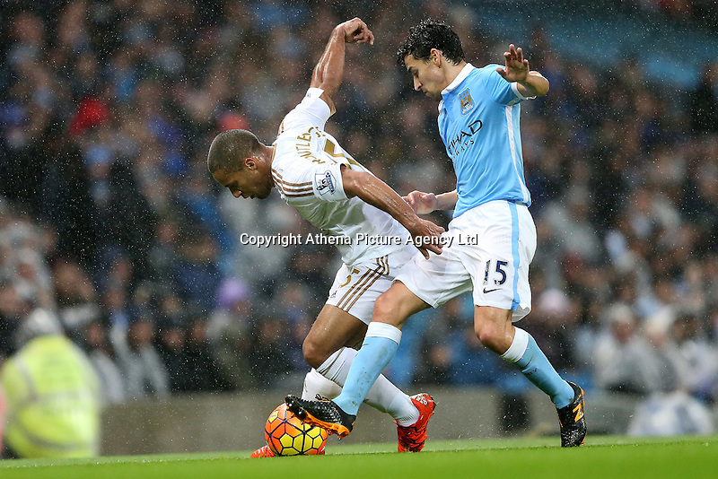 Wayne Routledge competes with Jesus Navas during the Barclays Premier League Match between Manchester City and Swansea City played at the Etihad Stadium, Manchester on 12th December 2015