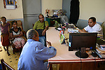 MADAGASCAR, Mananjary,  / MADAGASKAR, Mananjary, Fr. BENOIT URAN WUWUR SVD<br /> Steyler-Misisonar und Leiter der Kommission &quot;Justice et Paix&quot; (Justice and Peace) in der Di&ouml;zese Mananjary, beraet unklare Gerichtsfaelle am Amtsgericht mit JEAN-BAPTISTE MONY , Magistrat und Vorsitzender am Amtsgericht, Fall von FRANCOIS XAVIER RABOTSON wird des Mordes bezichtigt (er ist nicht auf den Fotos, sitzt im Gef&auml;ngnis, bei der Anh&ouml;rung dabei: Vater JEAN BOTO (&auml;lterer Mann mit blauer Jacke)<br /> mit seiner Schwiegertochter und Enkelin