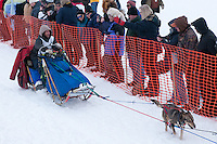 Musher # 34 Sebastian Schnuelle at the Restart of the 2009 Iditarod in Willow Alaska