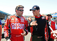 Apr 17, 2009; Avondale, AZ, USA; NASCAR Sprint Cup Series driver Tony Stewart (left) talks with Dexter Bean during practice for the Subway Fresh Fit 500 at Phoenix International Raceway. Mandatory Credit: Mark J. Rebilas-